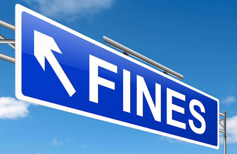 A blue sign that has the words 'FINES' on it.