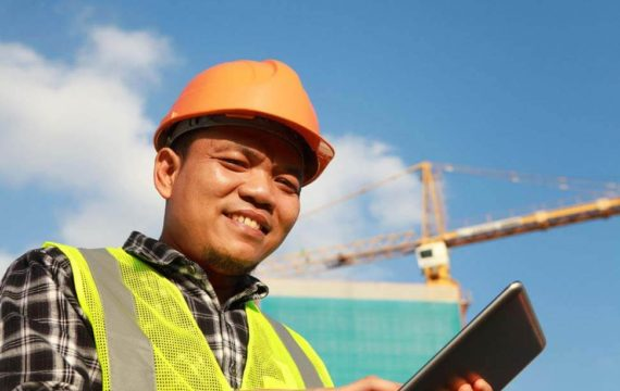 Competent construction worker with digital tablet