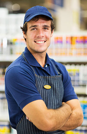 Grocery or hardware store clerk smiling at camera