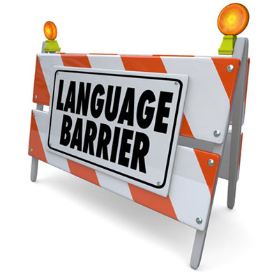 "Conceptual image of a construction barricade with a sign saying ""language barrier"""