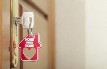 """Key with fob that says """"home sweet home"""""""