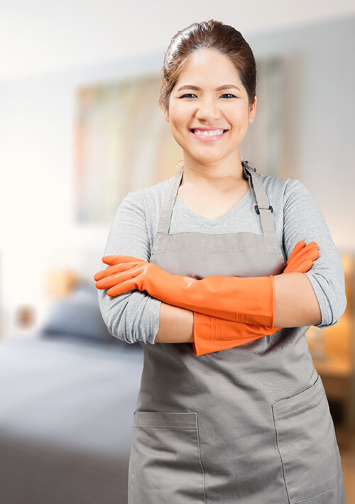 Smiling hotel housekeeper