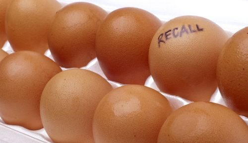 "A food allergens image of eggs with one marked ""Recall"" on it."