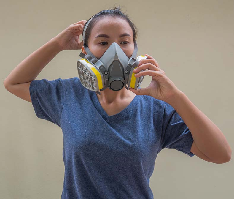 female wearing respirator