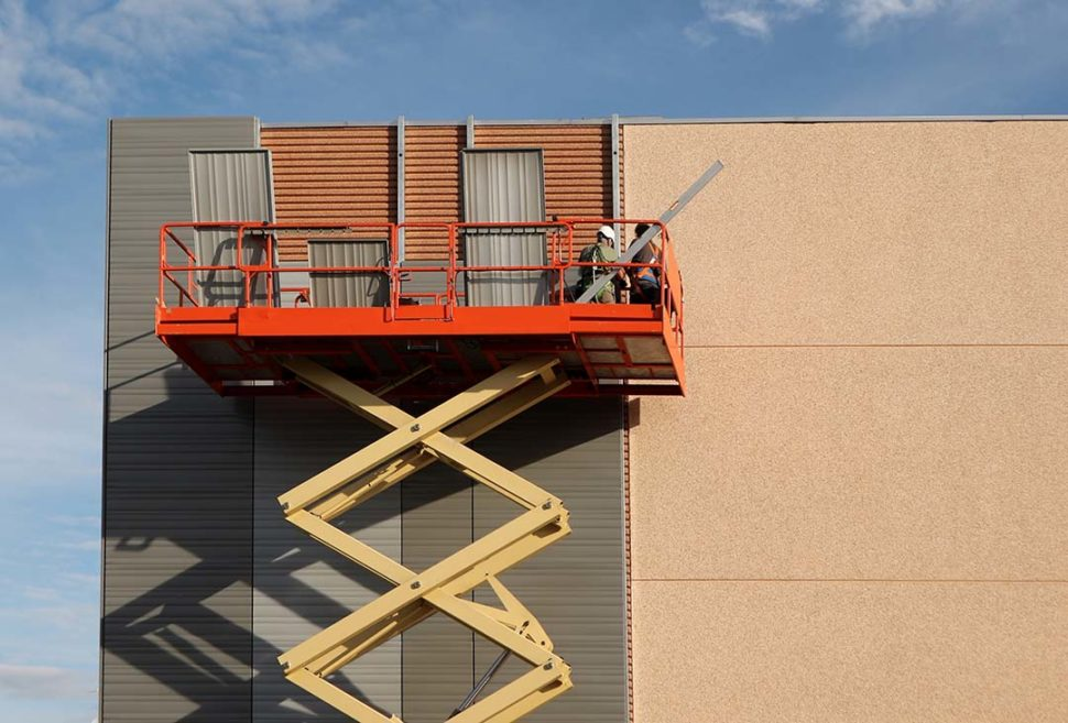 Workers on a scissor lift
