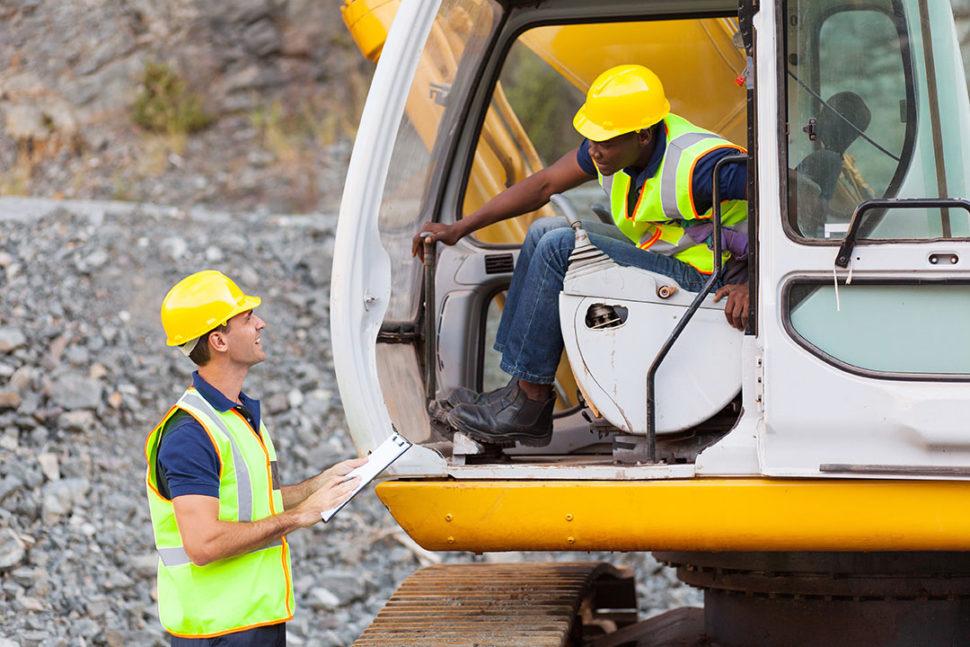 Supervisor ensuring safe excavation