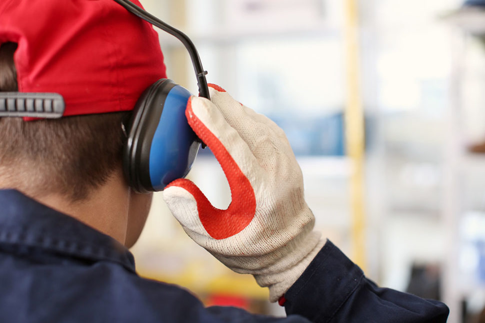 Employee wearing hearing protection