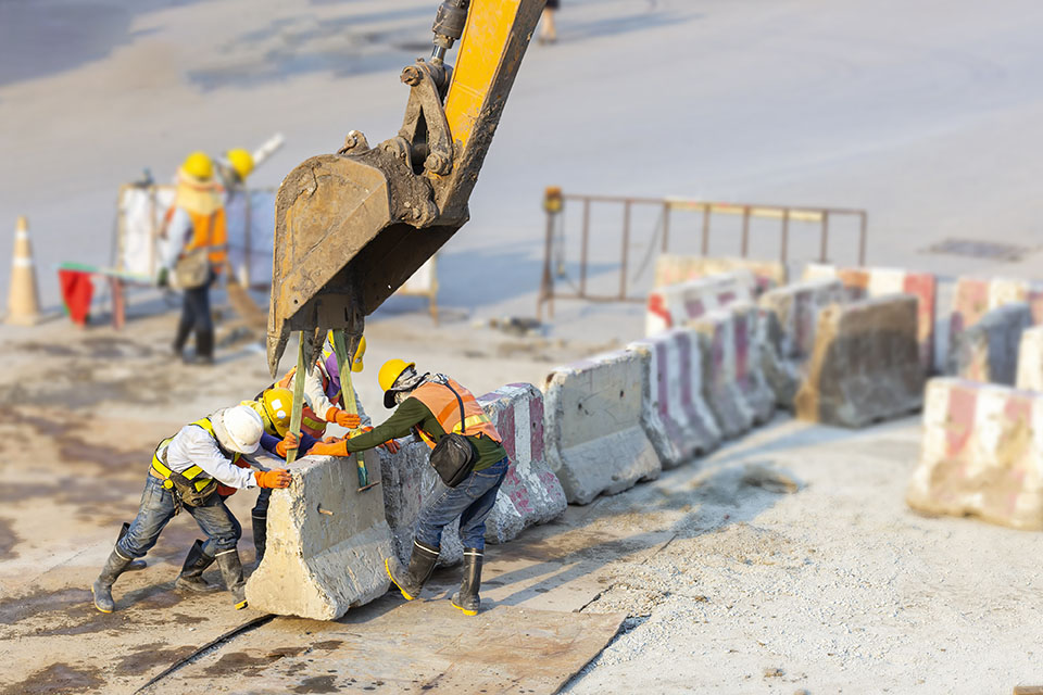 Concrete barrier to protect workers