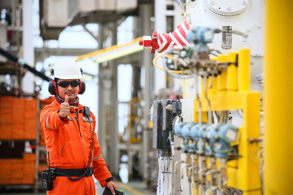 Oil and gas employee checking rig