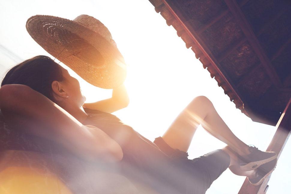 Woman resting under sun shelter