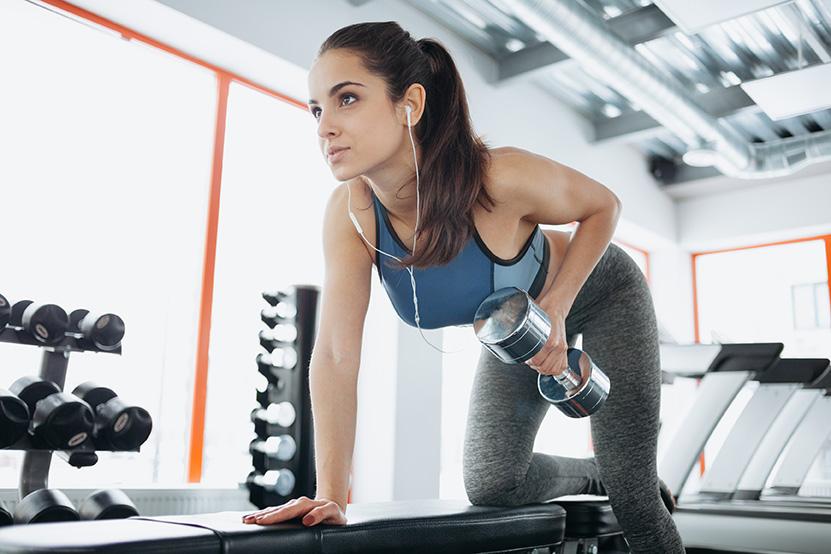 Female exercising to avoid back injury