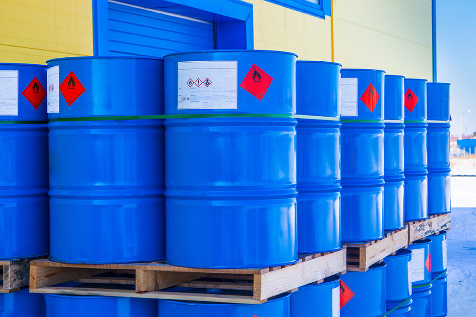 Chemicals in blue barrels