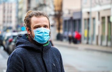 Male wearing surgical face mask