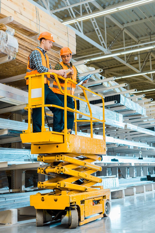 Warehouse workers on scissor lift