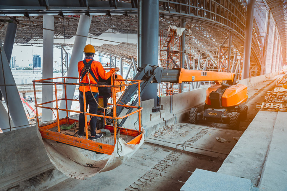 Construction employee on boom lift
