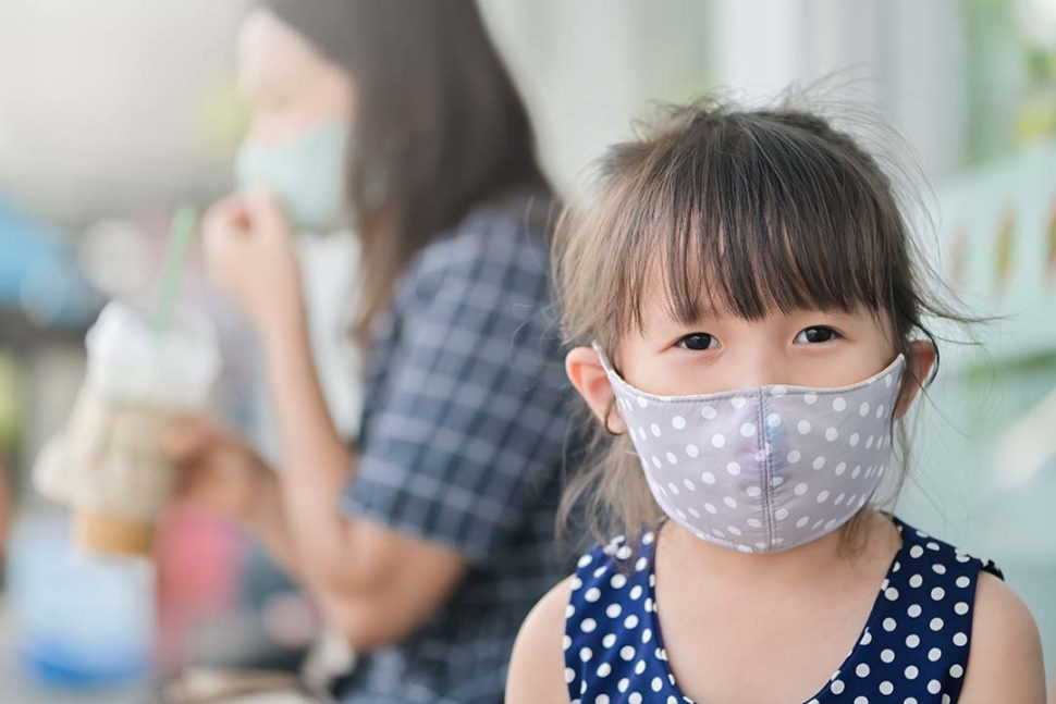 Cloth face mask on little girl