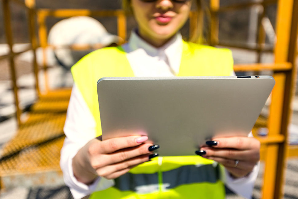 Worker using ipad for online training