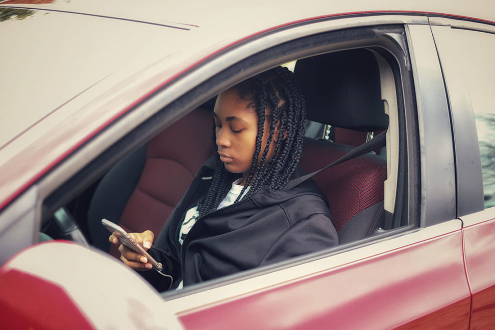 Female texting while driving