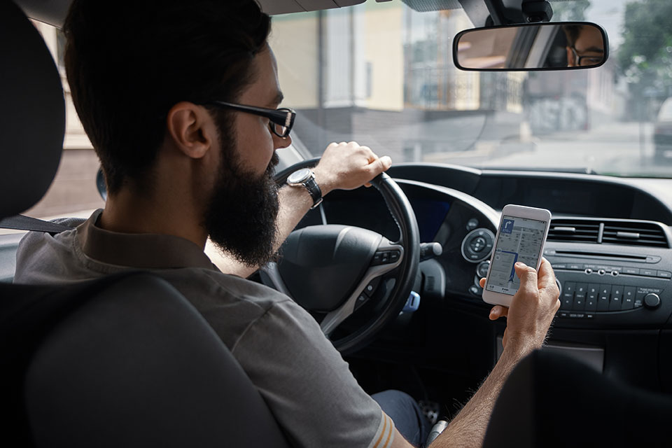 Man distracted by map driving