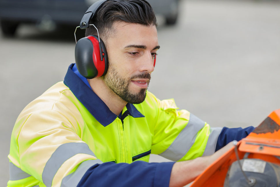 Employee with hearing protection