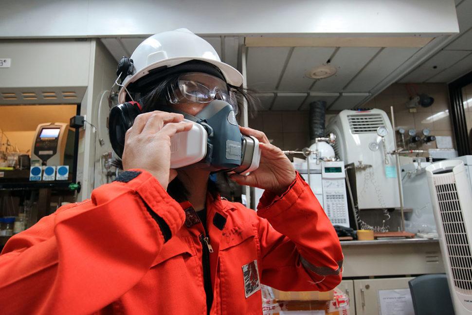 Employee wearing respirator