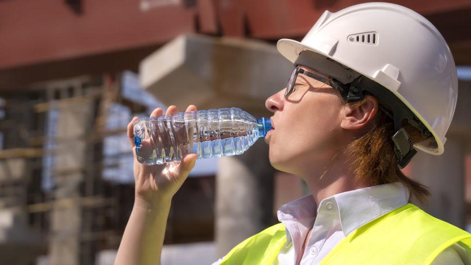 Female worker drinking water