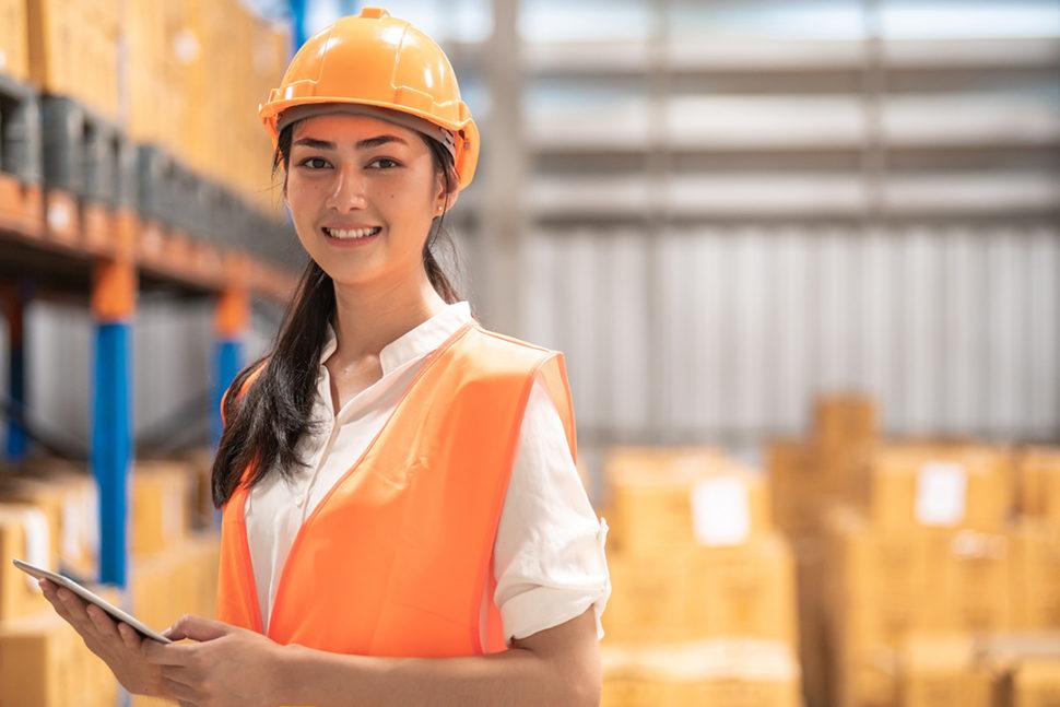 Female holding iPad in warehouse