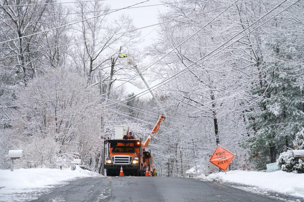 Workers fix powerlines in snow
