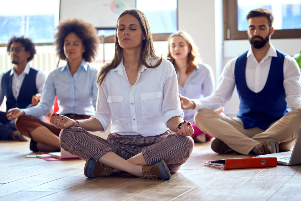 Coworkers meditate together