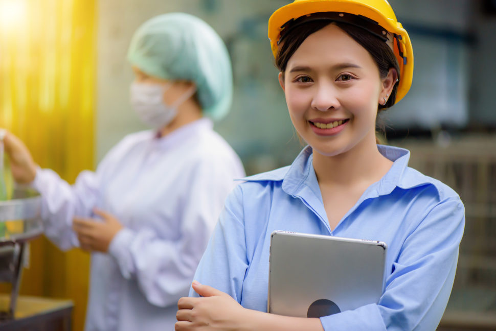 female construction worker holds ipad