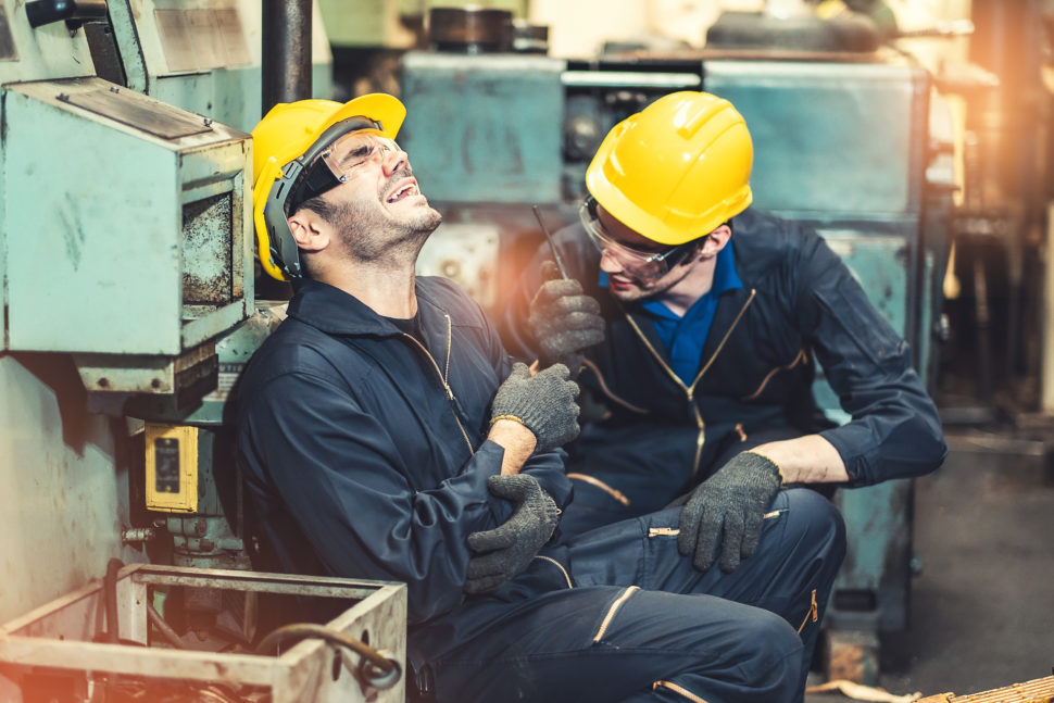 injured worker helped by another worker