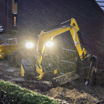Excavator working during a storm