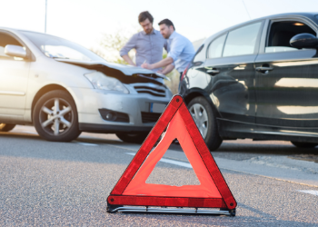 Two men examining a minor car accident