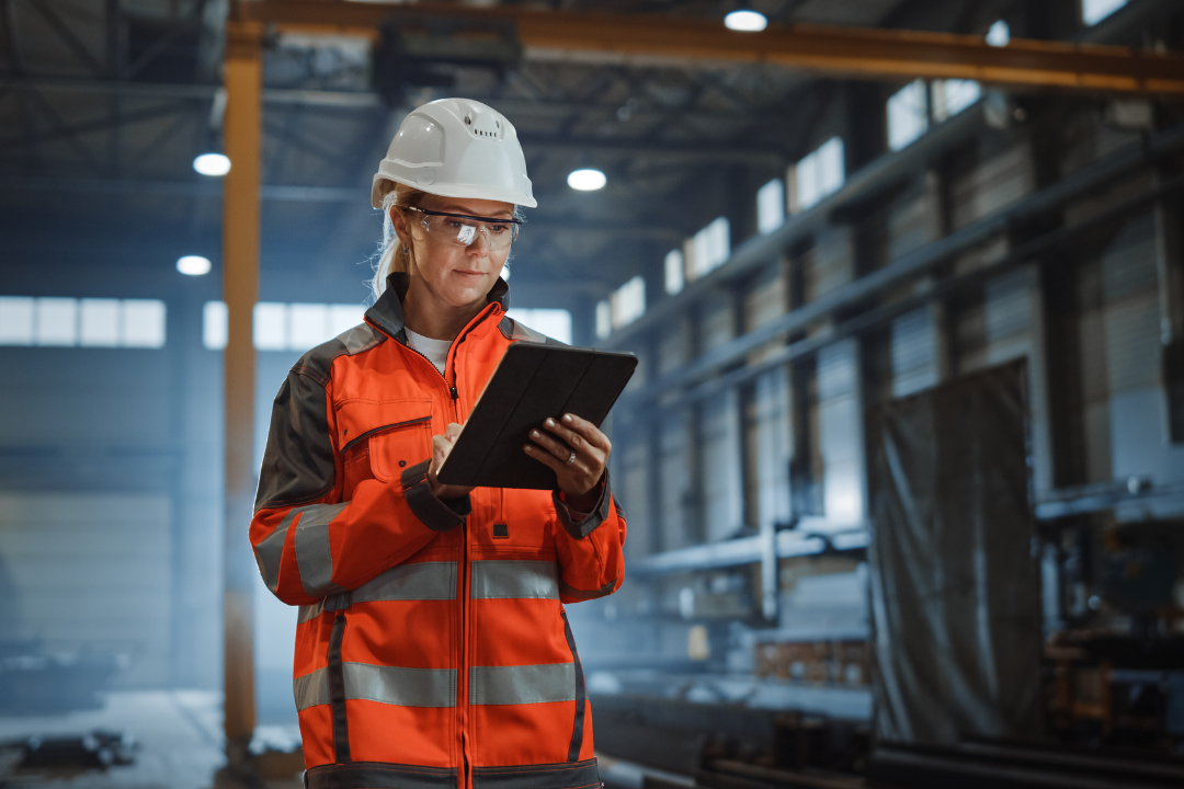 Female manufacturing worker on iPad